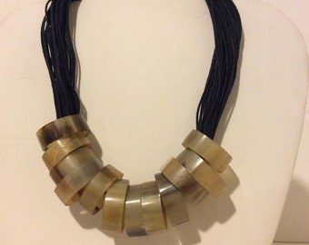 Short natural horn circles statement necklace