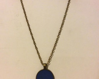 Cobalt blue and bronze round resin pendant necklace