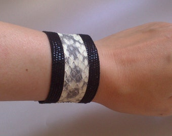 Bracelet typifies cuff(headline) black soft leather shiny and snake