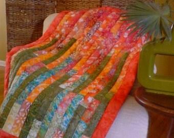 Boho style modern red/green/orange batik lap quilt