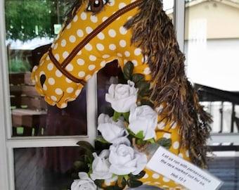 Mustard yellow white polka dot horse of encouragement.