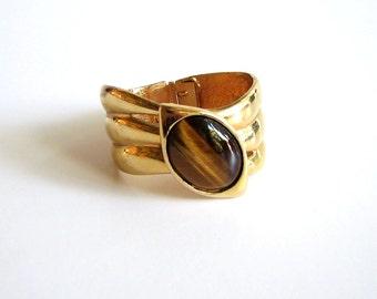 SALE bright gold and tigers eye bracelet . clamper bracelet . hinged bracelet