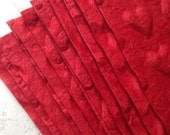 12 heart embossed papers