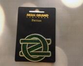 Wizard of Oz Signature Logo monogram MGM Grand Las Vegas pin sparkle button