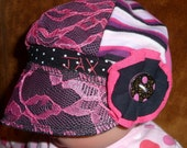 Toddler sized Jax Hat in pink and black prints and lace made from upcycled fabrics and handmade button - photos by Heatherbee