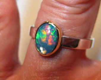 Ethiopian Opal Ring ... Sterling Silver and 14 kt Gold ... size  7 1/2... e858