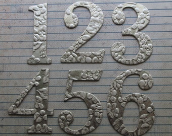 2 1/2 inch tall Numbers 1-12 silver with white embossed floral handmade cardstock over chipboard diecuts great for wedding table numbers