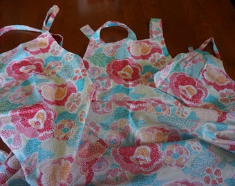 Apron set of three. Apron, children and American girl doll. Apron made from 100% cotton.