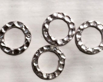 Six silver-finished steel, 12mm double-sided hammered round component.