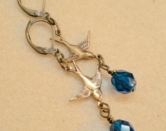 oO MERLE BLEU Oo brass birds and capri blue earrings