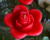 12 Red floating rose wedding candles for table centerpiece and reception decor.