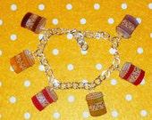 Cute little jam pot charm bracelet, Inc.  Jars of strawberry, raspberry, blackberry, apricot, plum and gooseberry. Yum