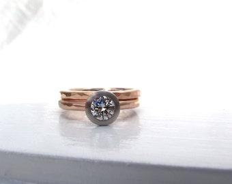 Dual tone mixed metal .50ct bezel set diamond engagement ring with matching wedding band