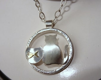 Handmade cat and fishbowl original sterling silver and brass pendant made by Norita Designs