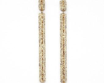 Handmade large long chandelier drop facet geometric statement dangle resin earrings in gold glitter sparkle.