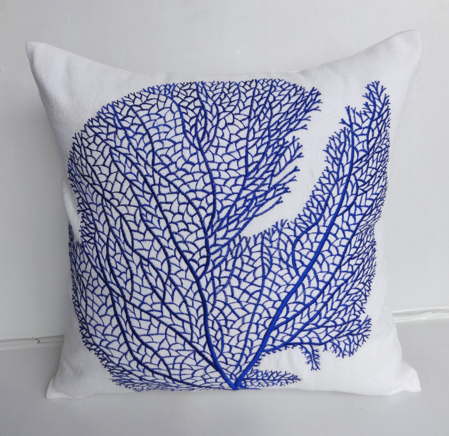 white and cobalt blue coral throw pillow coral fan embroided