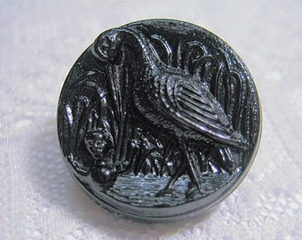 Antique Black Glass Button with Crane and Child in Water