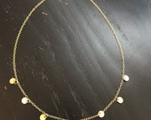 Mini gold circle charm and cable chain necklace