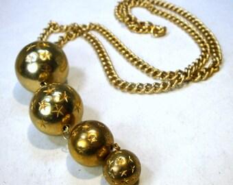 SALE, Graduated Gold Balls Articulated Long Pendant on Gold Chain, Star Designs on Each, 1960s Astrologic Tarot Stargazer Motif