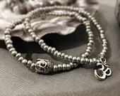 Buddha Om Bracelet set 2 bracelets stacking Czech glass seed beads stretchy silver jewelry