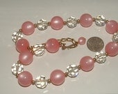reserve4erica--vintage- MOONGLOW LUCITE- signed NAPIER- authentic old  glowing pink beads 12mm with cut crystals