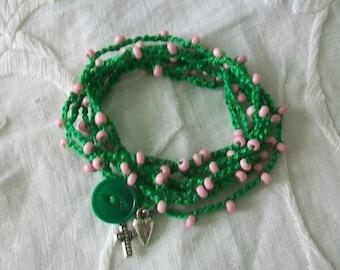 Wrap bracelet, Boho tribal, Multi layer, Stacking bracelet, Pink seed beads, Green crocheted fiber, Vintage button, Charm dangles