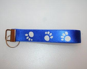 nylon webbing reflective paw prints on royal blue key chain fob wristlet