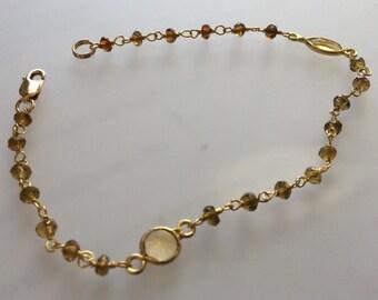 Tourmaline, gold, and various gemstone Bracelet
