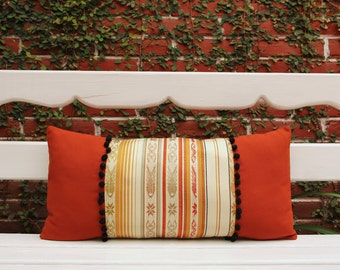 Lumbar Pillow with handwoven textiles, pompoms and cotton canvas