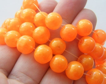 86 Orange glitter glass beads B176