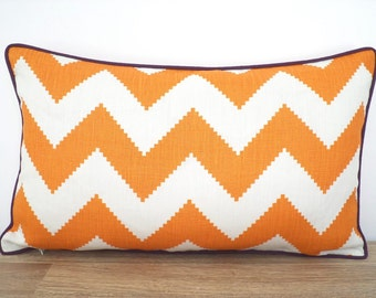 Orange chevron lumbar pillow cover with plum piping