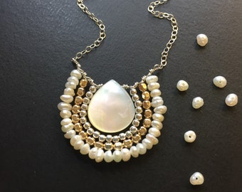 Pearl and mixed metal pendant necklace