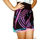 Geometrical pattern colorful striped black short with neon pom pom, reconstructed upcycle slothing