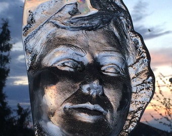 Glass sculpture portrait of a woman, sand cast face, prism lens optical art suncatcher mask