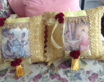 Two Victorian pillows with images of ladies