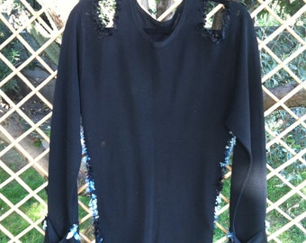 re worked, artistically altered black sweater