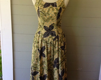 1970s Drop Waist Dress with Side Pockets / Deep Scooped Pretty Back / Wide Sash Makes Bow at Back / Gold Green and Black Jungle Leaf Print