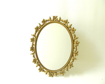 Vintage Syroco wall mirror, vanity, gold, oval, hollywood regency, 1960s