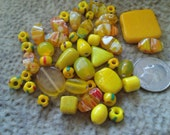 Mix of beads from now and then.Yellow vintage glass and ceramic  beads.