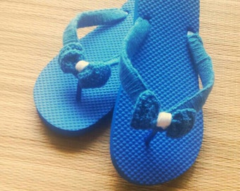 Size 7/8 Grecian blue flip flops with crochet and crochet bow by The Queens hand for Tanama