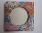 vintage porcelain picture frame, Asian, multi colored flowers, 5 inches square, round opening.