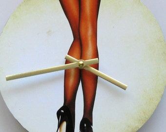 Wall clock. Clock for men. Women's legs. Fun clock. Body anatomy.