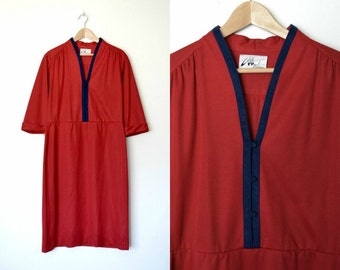 Vintage 80s red dress Navy trim around collar and has buttons down to waist Fold over sleeves Plus size / size X-large