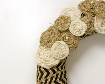 Burlap ribbon in chevron pattern covered wreath with burlap rosettes