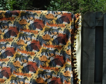African Safari: Fleece Tied Blanket with Light Yellow Lining