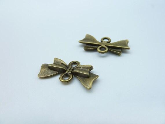 30pcs 10x20mm Antique Bronze Butterfly Bow Connector Link Charm Pendant c121