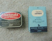 Two vintage medical packages tin & card Aspirin Meloids