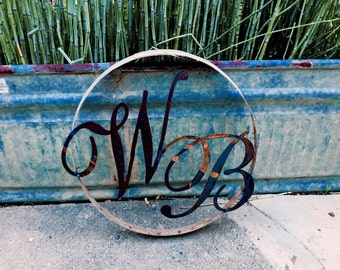 2 letter Monogram welded to wine barrel ring
