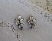 a pair of vintage clip on jeweled earrings