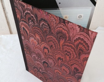 iPad mini case.  Made from new and recycled materials, with marlbed paper cover